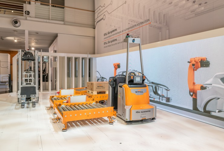 Automated interaction with high lift pallet truck, electric tractor and E-Frame
